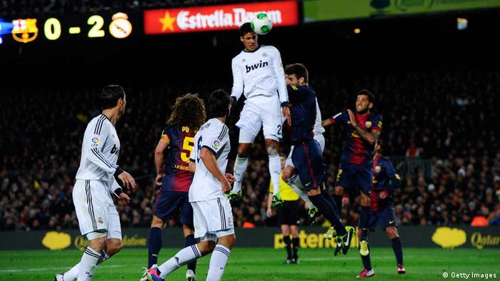 BARCELONA, SPAIN - FEBRUARY 26: Varane of Real Madrid CF scores his team's third goal during the Copa del Rey Semi Final second leg between FC Barcelona and Real Madrid at Camp Nou on February 26, 2013 in Barcelona, Spain. (Photo by David Ramos/Getty Images)