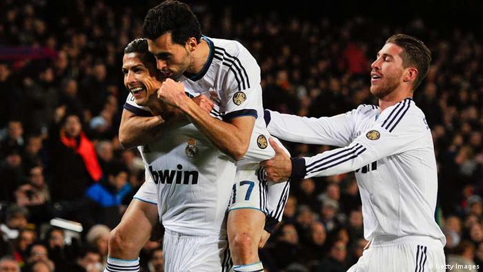 BARCELONA, SPAIN - FEBRUARY 26: Cristiano Ronaldo (L) of Real Madrid CF celebrates with his team-mates Alvaro Arbeloa (C) and Sergio Ramos after scoring his team's their goal during the Copa del Rey Semi Final second leg between FC Barcelona and Real Madrid at Camp Nou on February 26, 2013 in Barcelona, Spain. (Photo by David Ramos/Getty Images)
