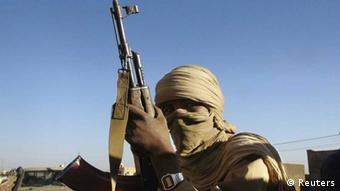 A soldier from the Tuareg rebel group MNLA holds an AK-47 in the northeastern town of Kidal February 4, 2013. REUTERS/Cheick Diouara