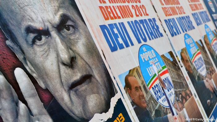Electoral placards showing Democratic Party (PD) leader Pier Luigi Bersani (L) and right-wing Silvio Berlusconi are displayed on a wall in Rome on February 26, 2013. (Photo: GABRIEL BOUYS/AFP/Getty Images)