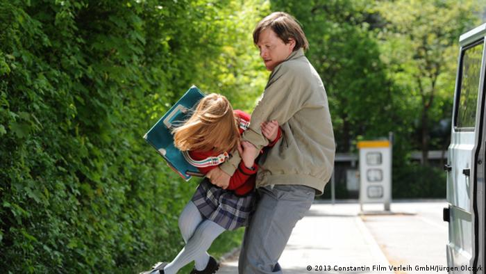 Wolfgang Priklopil (Thure Lindhardt) kidnaps Natascha Kampusch (Amelia Pidgeon) in the film 3,096 Days