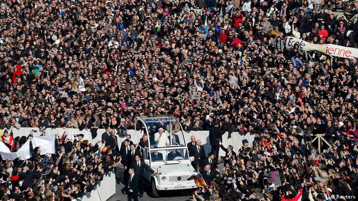 Pope Benedict XVI waves from his Popemobile as he rides through a packed Saint Peter's Square at the Vatican during his last general audience, February 27, 2013. The weekly event which would normally be held in a vast auditorium in winter, but has been moved outdoors to St. Peter's Square so more people can attend. The pope has two days left before he takes the historic step of becoming the first pontiff in some six centuries to step down instead of ruling for life. REUTERS/Stefano Rellandini (VATICAN - Tags: RELIGION)