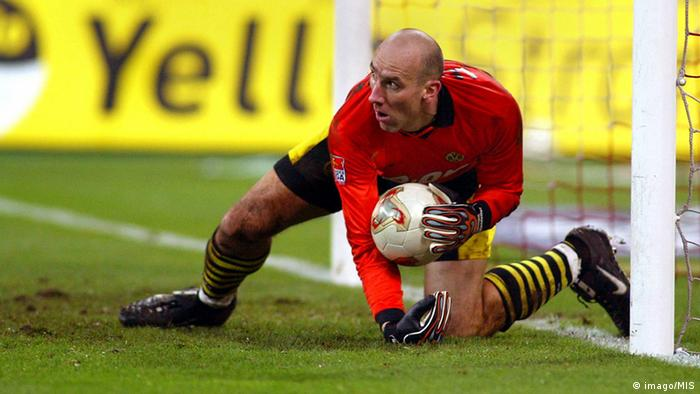 Jan Koller gathers up the ball in front of his goal