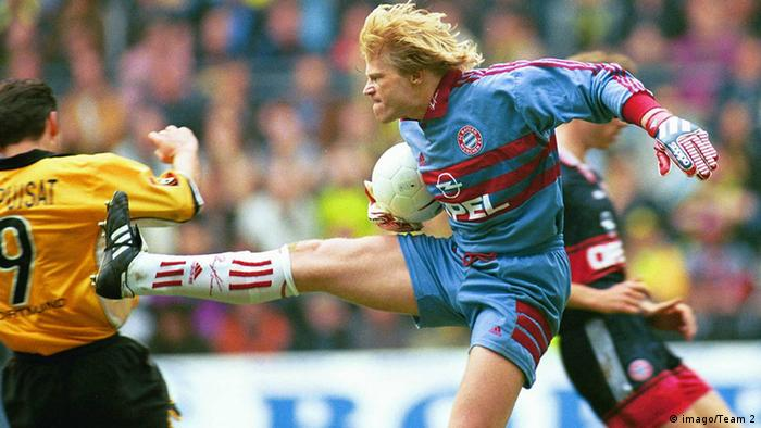 Oliver Kahn kicks at Stephane Chapuisat with the studs showing.