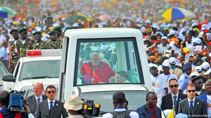 Pope Benedict in his popemobile in Angola EPA/CIRO FUSCO
