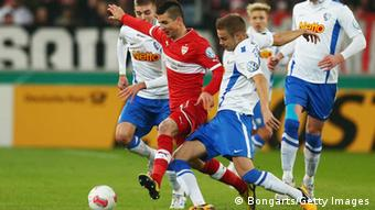 STUTTGART, GERMANY - FEBRUARY 27: Vedad Ibisevic of Stuttgart is challenged by Holmar Eyjolfsson of Bochum during the DFB Cup Quarter Final match between VfB Stuttgart and VfL Bochum at the Mercedes-Benz Arena on February 27, 2013 in Stuttgart, Germany. (Photo by Alex Grimm/Bongarts/Getty Images)