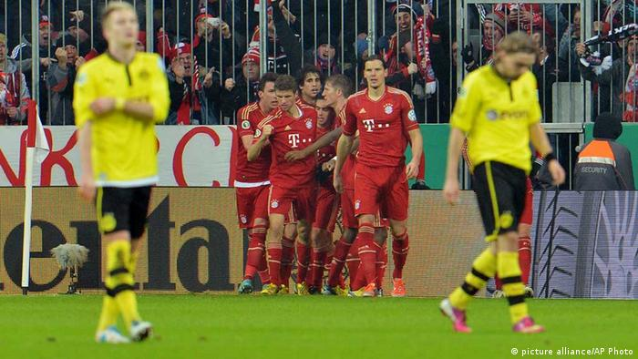 Munich's players celebrate after scoring during the German Soccer Cup (DFB Pokal) quarterfinal match between FC Bayern Munich and Borussia Dortmund in Munich, southern Germany Wednesday, Feb. 27, 2013. (AP Photo/Kerstin Joensson)