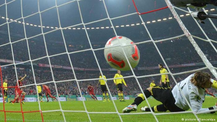 Ball enters net behind Dortmund goalkeeper Roman Weidenfeller.