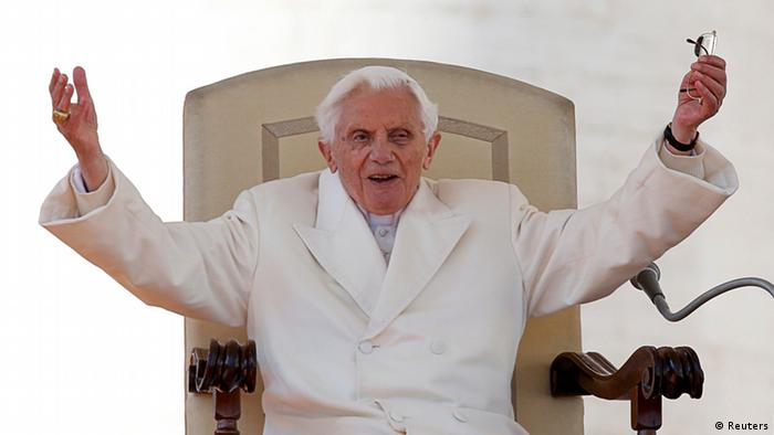 Pope Benedict XVI greets the crowd (Reuters)