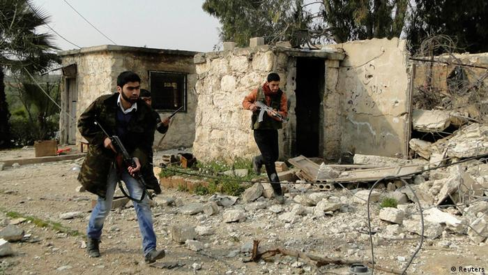 Free Syrian Army fighters carry their weapons and deploy after they seized control of regime's 80th Brigade's base near Aleppo International Airport, February 23, 2013. (Photo: Reuters/Mahmoud Hassano)