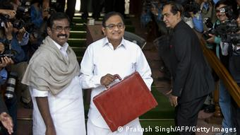Indian Finance Minister P. Chidambaram (L) poses for media with Ministers of State for Finance S.S. Palanimanickam (L) while Namo Narain Meena (R) walks away following his arrival at Parliament (Photo PRAKASH SINGH/AFP/Getty Images)