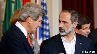 US Secretary of State John Kerry (left) talks with New Syrian National Coalition head Mouaz al-Khatib during a meeting at Villa Madama in Rome Photo: REUTERS/Remo Casilli