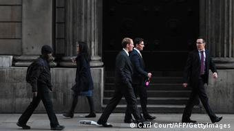 People walk past the Bank of England in the City of London. (Photo: AFP PHOTO / CARL COURT GettyImages)