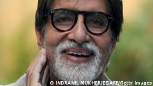 Indian Bollywood actor Amitabh Bachchan gestures during a press conference in Mumbai on February 9, 2013. The Bachchan family pledged to donate the proceeds of a book to the Plan India charity organisation, which supports the protection and rights of newborn girls in the country. Married women in India face huge pressure to produce male heirs, who are seen as breadwinners while girls are often viewed as a burden to the family as they require hefty dowries to be married off. AFP PHOTO/Indranil MUKHERJEE (Photo credit should read INDRANIL MUKHERJEE/AFP/Getty Images)