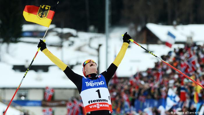 Eric Frenzel of Germany celebrates after crossing the finish line to win the cross country portion of the Nordic Combined Individual Large Hill / Gundersen competition at the Nordic Skiing World Championships in Val di Fiemme, Italy, 28 February 2013. (Photo: Hendrik Schmidt/dpa)