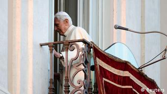 Pope Benedict XVI leaves as he appears for the last time at the balcony of his summer residence in Castelgandolfo, south of Rome, February 28, 2013. REUTERS/Max Rossi (ITALY - Tags: RELIGION)
