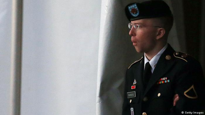 Bradley E. Manning is escorted from a hearing, on January 8, 2013 in Fort Meade, Maryland. (Photo via Mark Wilson/Getty Images)
