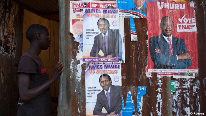 A boy enters an house with various campaign posters at the Kangemi slum in Kenya's capital Nairobi February 28, 2013. Kenya will hold its presidential and parliamentary elections on March 4.(Photo: Siegfried Modola/Reuters)