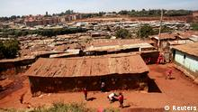 A general view shows the Kibera slum, home to over 1 million people in Kenya's capital Nairobi, February 25, 2013. Kenya's landlocked neighbours are stocking up on fuel and food to prevent the kind of disruption they suffered after being cut off from the port of Mombasa by angry rioters following a disputed election five years ago. About 200 million people in Uganda, Rwanda, Burundi, South Sudan and eastern Congo could be affected if Kenya goes through a fresh bout of fighting when it holds presidential and parliamentary elections on March 4. REUTERS/Thomas Mukoya (KENYA - Tags: SOCIETY POLITICS ELECTIONS BUSINESS)