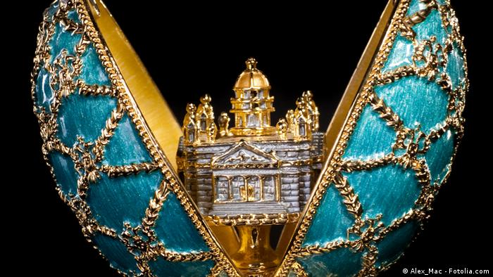 Faberge Egg, turquoise and gold with tiny house inside (Alex_Mac - Fotolia.com)