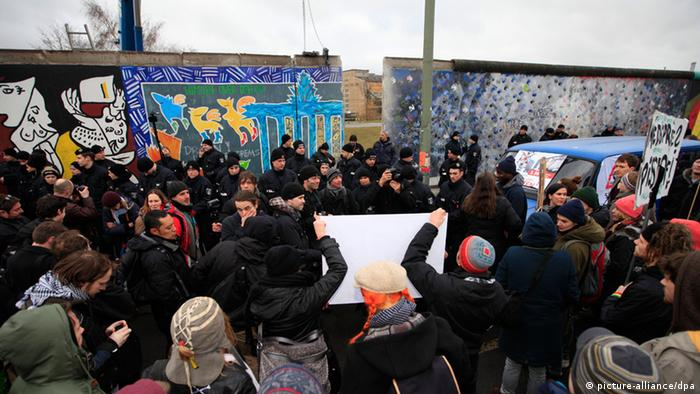 Demonstrators protest plans to remove a portion of the East Side Gallery in Berlin