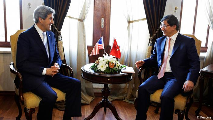U.S. Secretary of State John Kerry (L) speaks with Turkish Foreign Minister Ahmet Davutoglu during their meeting at Ankara Palas in Ankara March 1, 2013. REUTERS/Jacquelyn Martin/Pool (TURKEY - Tags: POLITICS)