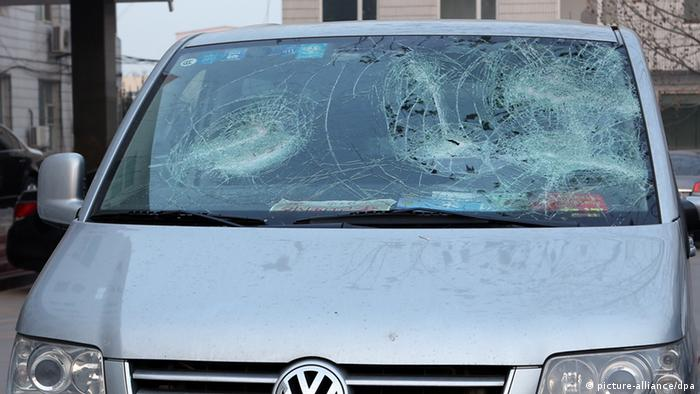 A handout from NDR shows the shattered windscreen ARD car in China. Photo: NDR