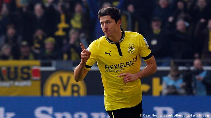 DORTMUND, GERMANY - MARCH 02: Robert Lewandowski of Dortmund celebrates afterhe shoots and scores the first goal of the game during the Bundesliga match between Borussia Dortmund and Hannover 96 at Signal Iduna Park on March 2, 2013 in Dortmund, Germany. (Photo by Dean Mouhtaropoulos/Bongarts/Getty Images)