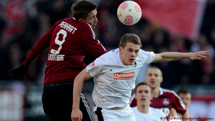 NUREMBERG, GERMANY - MARCH 02: Tomas Pekhart (L) of Nuernberg and Matthias Ginter of Freiburg jump for a header during the Bundesliga Match between 1. FC Nuernberg and SC Freibug at Grundig Stadion on March 2, 2013 in Nuremberg, Germany. (Photo by Micha Will/Bongarts/Getty Images)