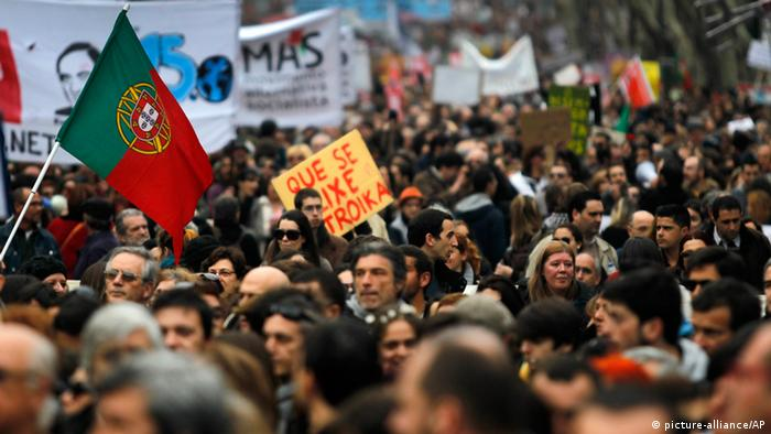 Many thousands march down Lisbon's main Liberdade avenue during a protest against austerity measures taken by the Portuguese government in exchange of a euro 78 billion ($101 billion) international bailout needed in 2011, Saturday, March 2, 2013. (AP Photo/Francisco Seco)
