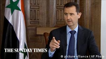 ***ACHTUNG: Bild nur zur zeitnahen (24 Stunden) Berichterstattung über das Interview verwenden!!!*** In this image taken from video filmed on Thursday, Feb. 28, 2013 and released Saturday evening, March 2, 2013, Syrian President Bashar Assad speaks during an interview with the Sunday Times, in Damascus, Syria. Iran and Syria condemned a U.S. plan to assist rebels fighting to topple Assad on Saturday and signaled the Syrian leader intends to stay in power at least until 2014 presidential elections. Assad told the Sunday Times in the interview timed to coincide with U.S. Secretary of State John Kerry's first foreign trip that the intelligence, communication and financial assistance being provided is very lethal. Kerry announced on Thursday that the Obama administration was giving an additional $60 million in assistance to Syria's political opposition and would, for the first time, provide non-lethal aid directly to the rebels. (AP Photo/Sunday Times via AP video) THIS IMAGE IS FOR USE FOR 24 HOUR NEWS ACCESS ONLY, SUNDAY TIMES LOGO MUST NOT BE OBSCURED, NO ARCHIVES, NO SALES /PLEASE CONTACT SUNDAY TIMES SYNDICATION DEPARTMENT BY EMAIL TO ENQUIRIES@NISYNDICATION.COM FOR QUESTIONS REGARDING USE OUTSIDE THE 24 HOUR NEWS ACCESS WINDOW