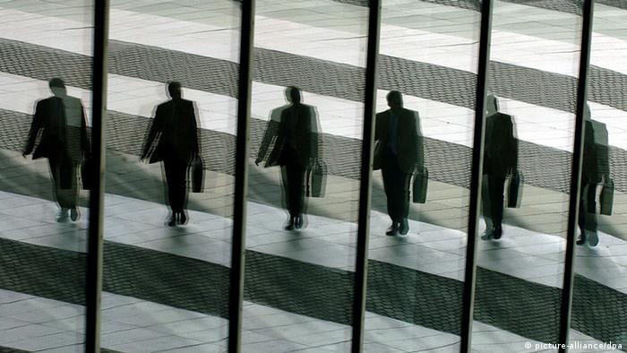 A series of images shows a man walking in a suit with a briefcase