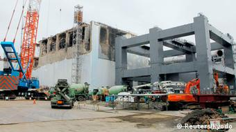 The No.4 reactor (L) and a foundation structure for the construction of a storage facility for melted fuel rods are seen at Tokyo Electric Power Co (TEPCO)'s tsunami-crippled Fukushima Daiichi nuclear power plant in Fukushima prefecture, in this photo released by Kyodo March 1, 2013, ahead of the second-year anniversary of the March 11, 2011 earthquake and tsunami. Mandatory Credit REUTERS/Kyodo (JAPAN - Tags: DISASTER ANNIVERSARY BUSINESS SCIENCE TECHNOLOGY CONSTRUCTION) ATTENTION EDITORS -THIS IMAGE HAS BEEN SUPPLIED BY A THIRD PARTY. IT IS DISTRIBUTED, EXACTLY AS RECEIVED BY REUTERS, AS A SERVICE TO CLIENTS. FOR EDITORIAL USE ONLY. NOT FOR SALE FOR MARKETING OR ADVERTISING CAMPAIGNS. MANDATORY CREDIT. JAPAN OUT. NO COMMERCIAL OR EDITORIAL SALES IN JAPAN. YES