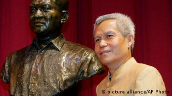 FILE - In this Aug. 31, 2005 file photo, Sombath Somphone of Laos, the winner of Ramon Magsaysay Award for Community Leadership in 2005, poses with the bust of the late Philippine president prior to receiving his award in ceremony at the Cultural Center of the Philippines in Manila. The respected social activist has gone missing in Laos, and a colleague involved in the search for him said that he saw evidence that police had taken him into custody. A statement issued Tuesday, Dec. 18, 2012 on behalf of 61 Thai nongovernmental organizations said Sombath disappeared Saturday afternoon in the Lao capital, Vientiane, where friends last saw him getting into his car to drive home from the development agency he founded. The Ramon Magsaysay Award is one of Asia's top civil honors. (AP Photo/Bullit Marquez, File)