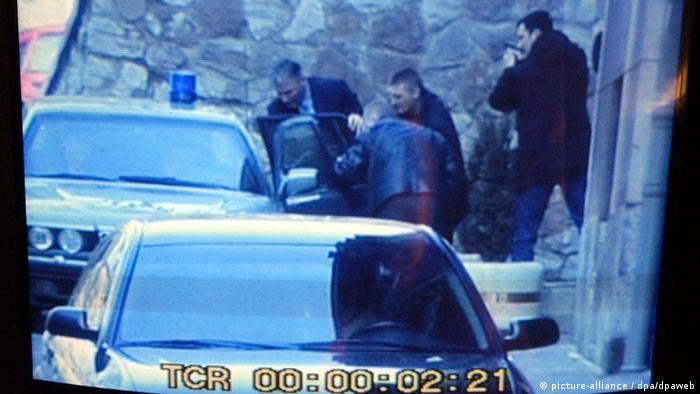 A surveillance camera picture of police around Djindjic's car after the killing
