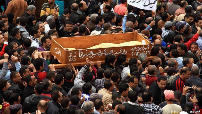 Thousands of residents join a funeral procession for civilians killed overnight during street battles with police forces, in Port Said, Egypt, Monday, March 4, 2013. (AP Photo/Ahmed Ramadan)