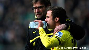 Borussia Dortmund manager Jurgen Klopp speaks to substitute Mario Gotze on the sidelines during the Bundesliga match between Borussia Dortmund and Hannover 96 at Signal Iduna Park on March 2, 2013 in Dortmund, Germany. (Photo: Dean Mouhtaropoulos/Bongarts/Getty Images)