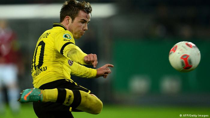 Mario Goetze scores during the German Cup football match Borussia Dortmund vs Hanover 96 in Dortmund (Photo via AFP)