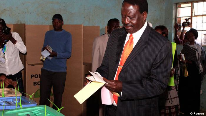 Kenya's Prime Minister and presidential candidate Raila Odinga votes at Kibera primary school during the presidential election in Nairobi March 4, 2013. Polling stations opened up to Kenyans on Monday for a tense presidential election that will test whether the east African nation can repair its damaged reputation after the tribal blood-letting that followed a 2007 poll. REUTERS/Noor Khamis (KENYA - Tags: ELECTIONS POLITICS)