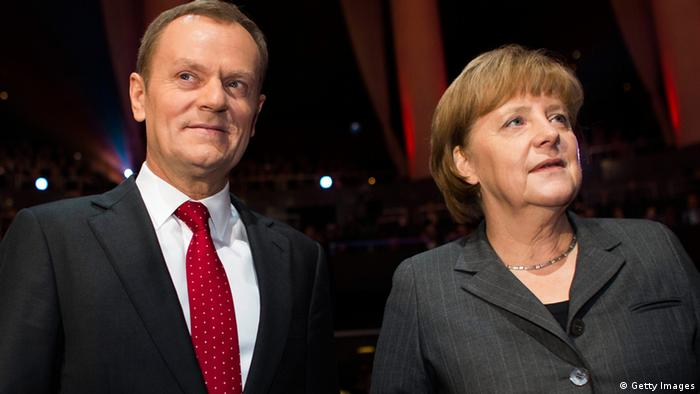 CeBIT 2013 Merkel und Tusk German Chancellor Angela Merkel (R) and Prime Minister of Poland Donald Tusk are pictured during the opening event of the world's largest computer expo CeBIT high-tech fair on March 4, 2013 in Hanover, central Germany. Poland is this year's partner country of the fair running from March 5 to 9, 2013. AFP PHOTO / CARSTEN KOALL (Photo credit should read CARSTEN KOALL/AFP/Getty Images)