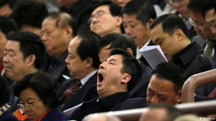 A delegate yawns during the opening ceremony of National People's Congress (NPC) at the Great Hall of the People in Beijing, March 5, 2013. REUTERS/Jason Lee (CHINA - Tags: POLITICS)