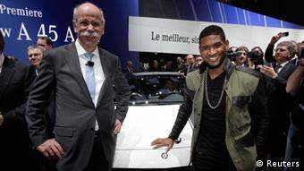 Daimler AG Chief Executive Dieter Zetsche (L) poses with recording artist Usher after the presentation of the new A 45 AMG model car during the first media day of the 83rd Geneva Car Show at the Palexpo Arena in Geneva March 5, 2013. The Geneva Motor Show will take place from March 7 to 17, 2017. REUTERS/Denis Balibouse (SWITZERLAND - Tags: TRANSPORT BUSINESS ENTERTAINMENT)