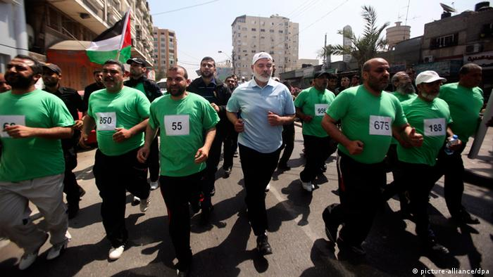 epa03220011 Palestinian Prime Minister of Hamas, Ismail Haniya (C), takes part in a marathon to mark Nakba day in Gaza City, Gaza Strip, 15 May 2012. Thousands marched in the West Bank and Gaza Strip, commemorating the dispersal of hundreds of thousands of Palestinians from their homes in the wake of the creation of Israel 64 years ago. Known in Arabic as the Nakba, or catastrophe, hundreds of thousands of Palestinians fled their homes during the war that erupted a day after Israel declared statehood on May 14, 1948. In Gaza City, crowds gathered ahead of a 1 pm (1000 GMT) rally, carrying a huge map of historic Palestine featuring every village that had exited before 1948, as well as a 300-metre-long Palestinian flag. EPA/ALI ALI