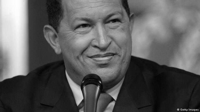 Venezuelan President Hugo Chavez smiles as he speaks at a press conference in Miraflores Palace December 5, 2006 in Caracas, Venezuela. Chavez was officially declared the re-elected president by electoral authorities today after defeating challenger Manuel Rosales in the December 3 election. (Photo by Mario Tama/Getty Images)