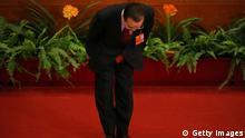 BEIJING, CHINA - MARCH 05: Chinese Premier Wen Jiabao bows after delivering the work report at the opening session of the annual National People's Congress at Great Hall of the People on March 5, 2013 in Beijing, China. Chinese Premier Wen Jiabao stressed Tuesday that the government should adopt effective measures to prevent and control pollution in response to people's expectations of having a good living environment. (Photo by Feng Li/Getty Images)