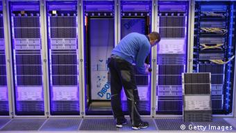 HANOVER, GERMANY - MARCH 04: A worker assembles a data center module container at the Rittal stand at the 2013 CeBIT technology trade fair the day before the fair opens to visitors on March 4, 2013 in Hanover, Germany. CeBIT will be open March 5-9. (Photo by Sean Gallup/Getty Images)
