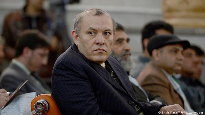 Former Chairman of Afghanistan's Kabul Bank, Sher Khan Farnoud (C) watches proceedings at a court in Kabul on March 5, 2013. A special court in Afghanistan has sentenced two senior executives to five years in jail for a multi-million-dollar fraud that caused the collapse of the Kabul Bank in 2010. Judge Shamsul Rahman Shams read out the verdicts and said the men must pay back money they gained from the sophisticated network of corruption in which cash was used to buy homes in Dubai, Britain, Switzerland and the United States. The bank's former chairman, Sher Khan Farnoud, and its former CEO Khalilullah Ferozi were both in court to hear the verdicts against them, along with some of the 20 other accused who were given sentences of between six months and four years. AFP PHOTO/ SHAH Marai (Photo credit should read SHAH MARAI/AFP/Getty Images)