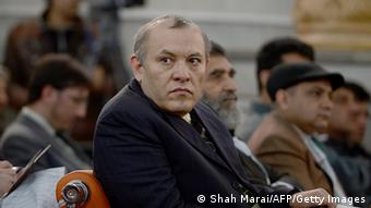 Former Chairman of Afghanistan's Kabul Bank, Sherkhan Farnood (C) watches proceedings at a court in Kabul on March 5, 2013. (Photo: SHAH MARAI/AFP/Getty Images)