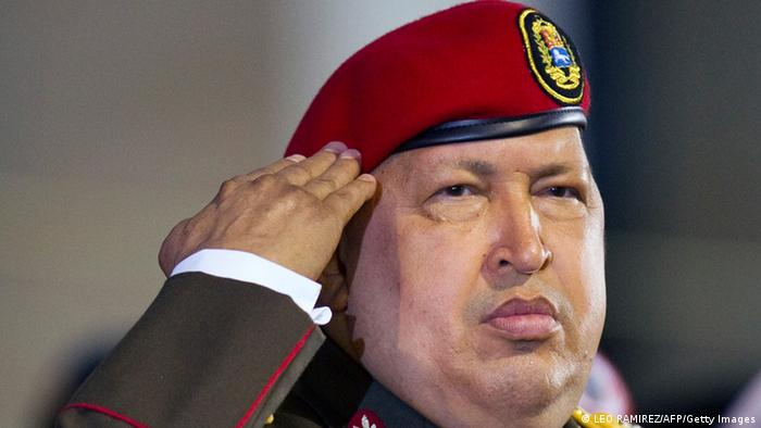Venezuelan President Hugo Chavez salutes during a military ceremony i Photo: LEO RAMIREZ/AFP/Getty Images