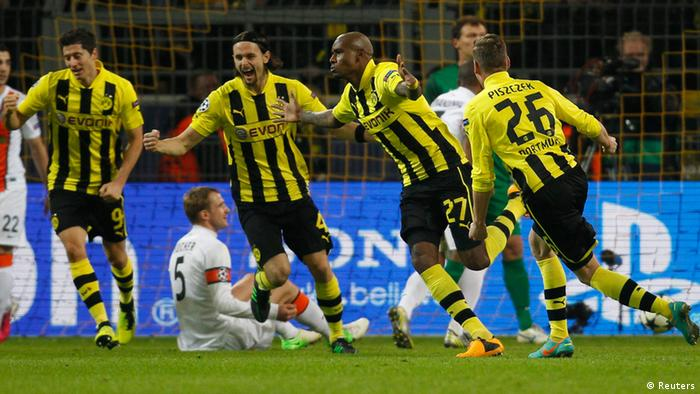 Borussia Dortmund's Felipe Santana (2nd R) and teammates celebrate a goal against Shakhtar Donetsk during the Champions League soccer match in Dortmund March 5, 2013. REUTERS/Ina Fassbender